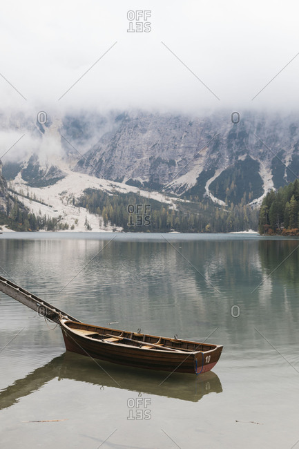 Several wooden boats moored in Lake Prags, South Tyrol, Italy