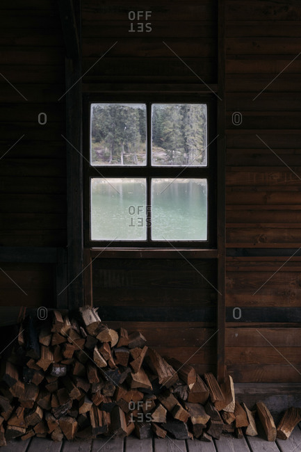 Firewood stacked in building on Lake Prags in South Tyrol, Italy
