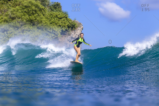 Indonesia- Bali- woman surfing