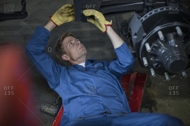 Industrial worker screwing in bolt