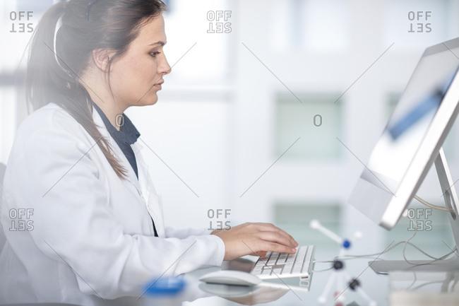 Scientist working in lab on computer