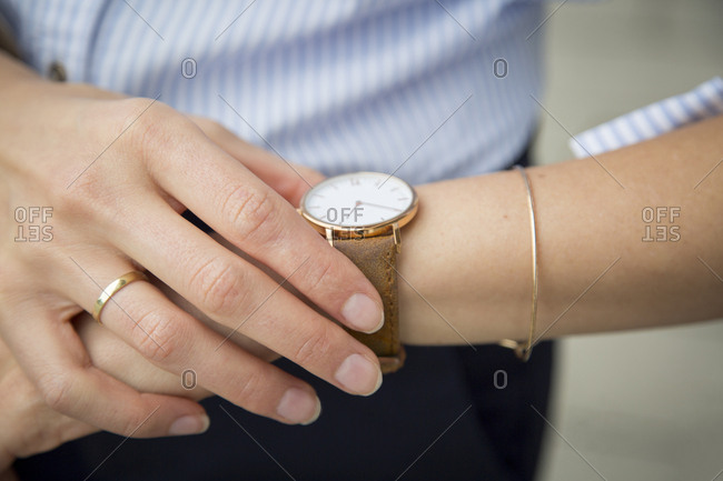 Businesswoman wearing wrist watch- close-up