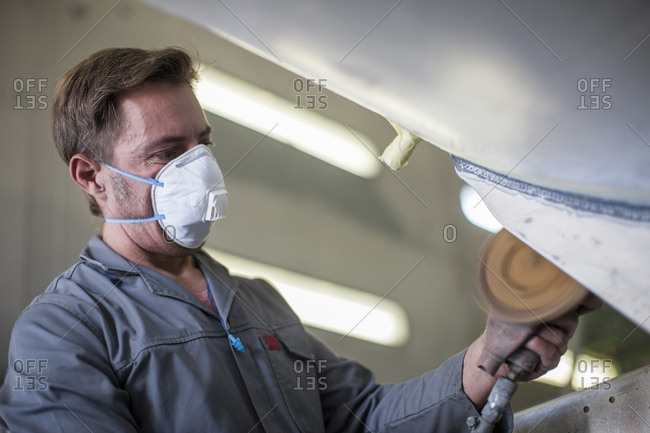 Industrial worker wearing protective mask