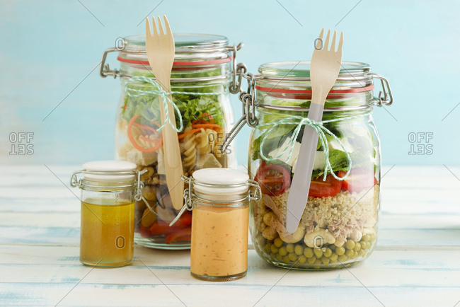 Preserving jars of mixed salads and jars of dressings