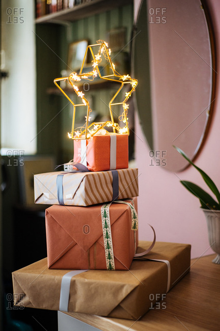 Christmas presents with illuminated star on top