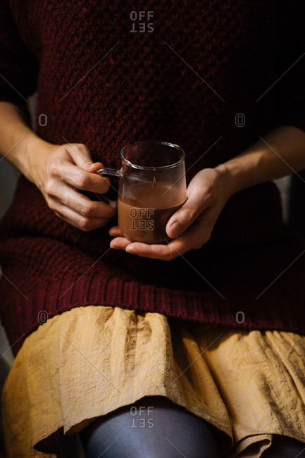 Woman holding a cup of thick hot chocolate