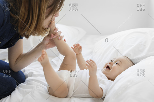 Mom kissing baby's foot