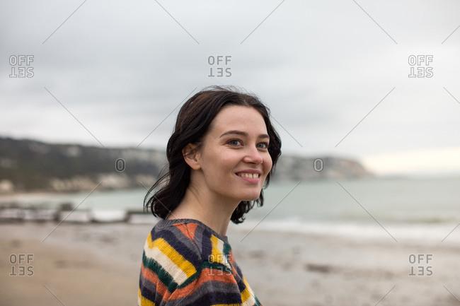 Happy young female on a winter beach break