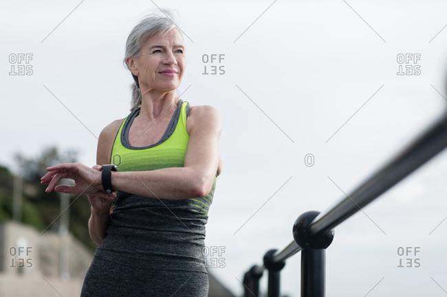 Senior woman warming up before a run