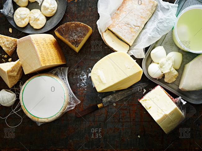 Selection of cheeses on work surface, overhead view