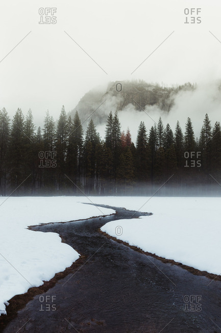 Snow covered landscape and winding river, Yosemite Village, California, USA