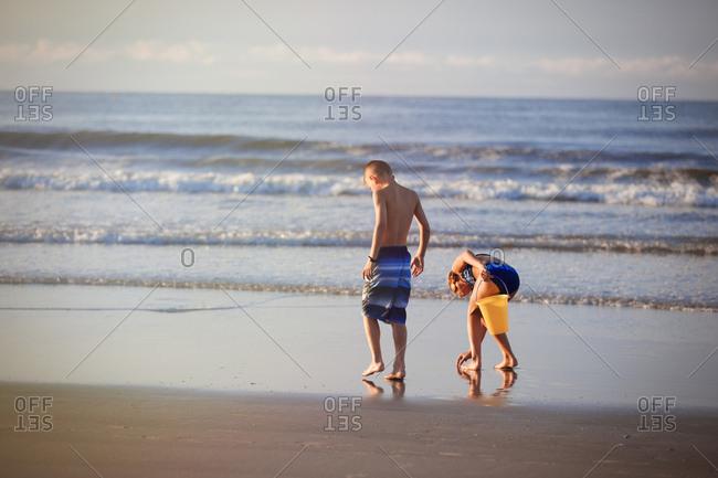 Girl and boy on beach, North Myrtle Beach, South Carolina, United States, North America