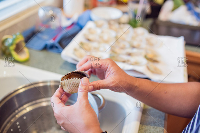 Woman preparing scallop dinner