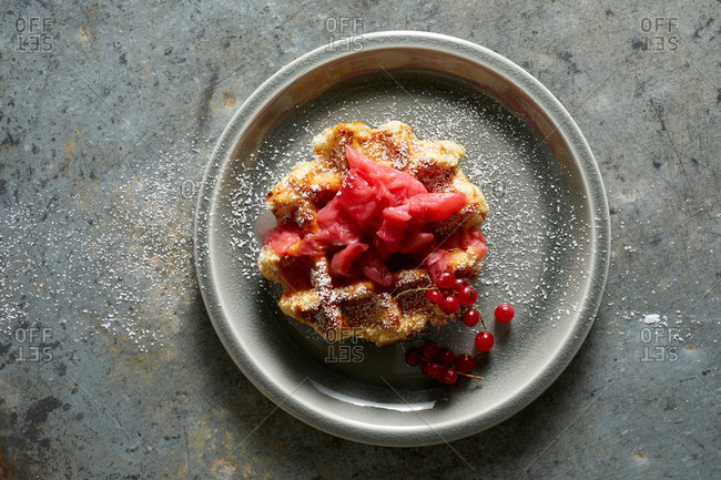 Waffle with strawberry rhubarb jam, redcurrants and powdered sugar