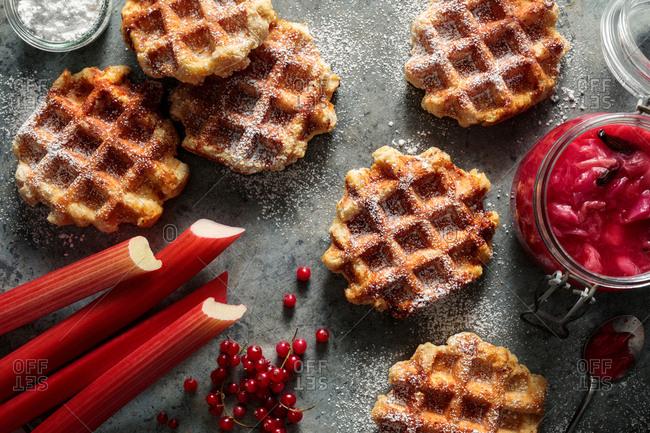 Waffle with strawberry rhubarb jam, redcurrants and powdered sugar