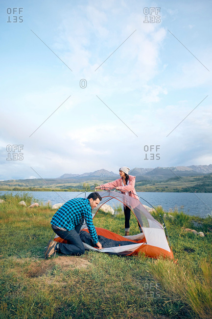 Couple in rural setting, putting up tent, Heeney, Colorado, United States