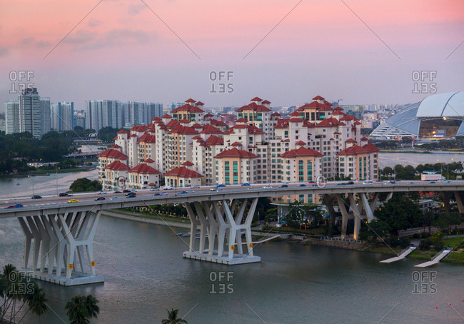 October 23, 2017: Elevated cityscape with highway bridge and apartment developments at dusk, Singapore, South East Asia