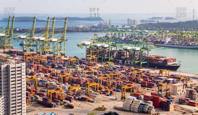 October 23, 2017: Elevated view of container terminal, cranes and container ship, Singapore, South East Asia