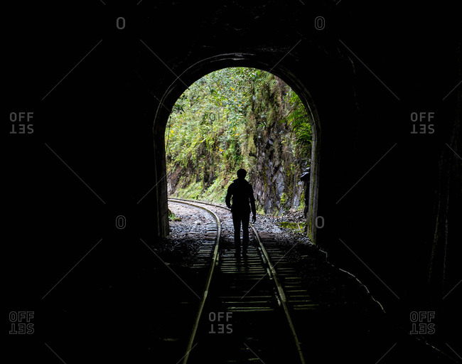 Hiker on train tracks that lead up to Aguas Calientesthe starting point for excursions to Machu Picchu, Peru