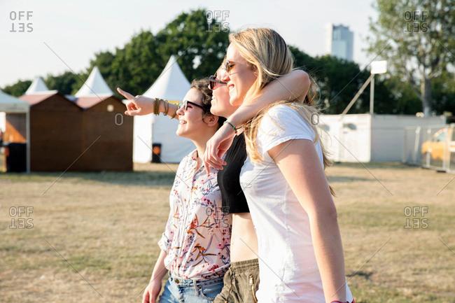 Three female friends enjoying festival