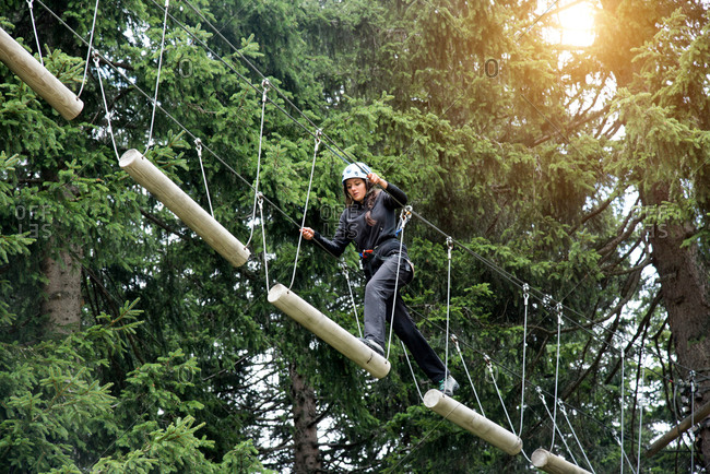 Teenage girl on high rope course