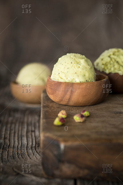 Scoops of ice cream in wooden bowls