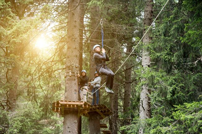 Teenage girl on zip wire