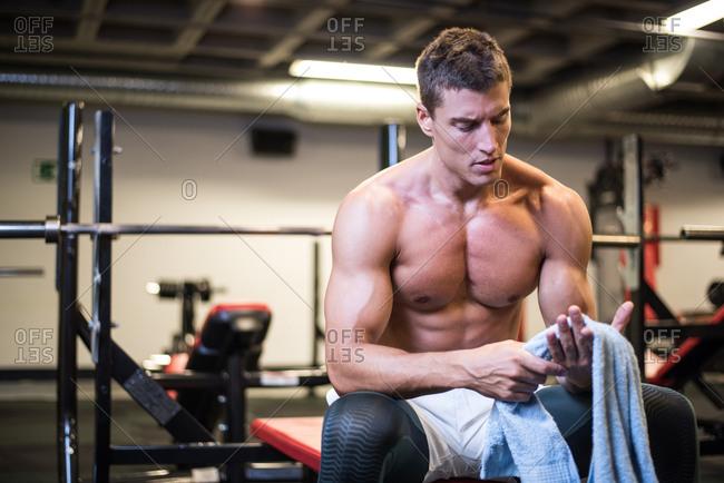 Muscular bodybuilder with towel