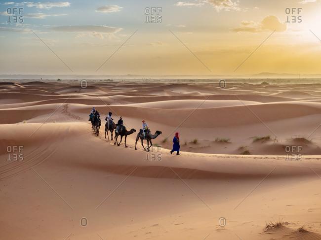 Merzouga, Morocco - October 26, 2015: Caravan walking in desert