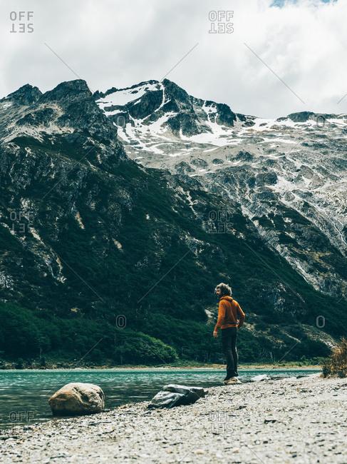 Ushuaia, Argentina - December 3, 2016: Traveler on lake in mountains