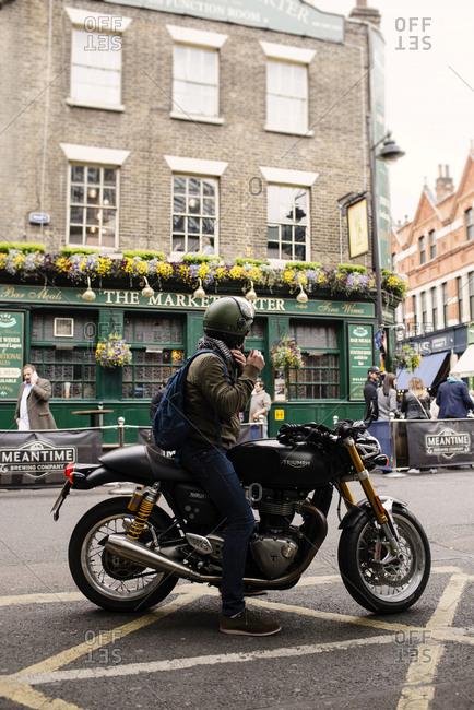 London, UK - May 4, 2017: LONDON, UK - MAY 4, 2017: Man riding a motorcycle