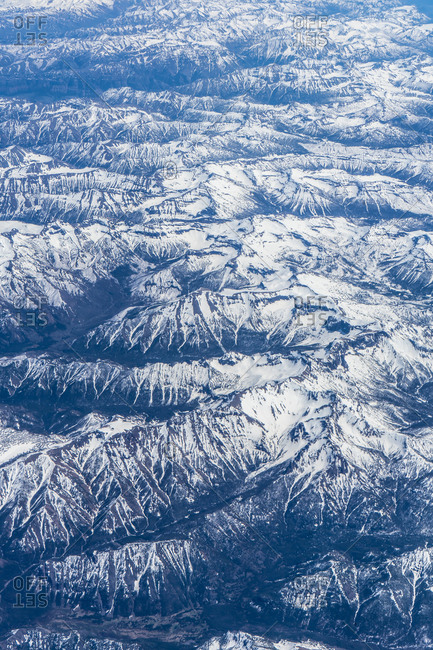 Aerial shot of mountains range with snowy caps