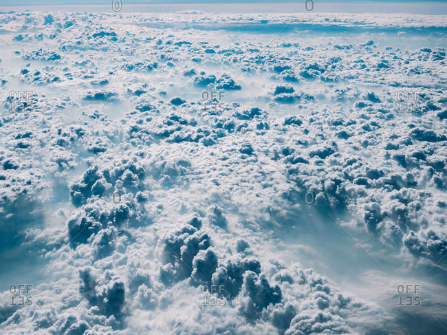 Abstract background of white and blue clouds creating spacious sphere