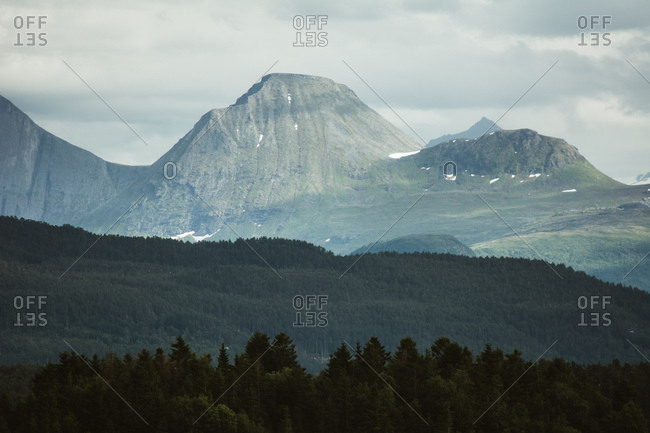 Wonderful view of mountains ridge with coniferous woods terrain in front