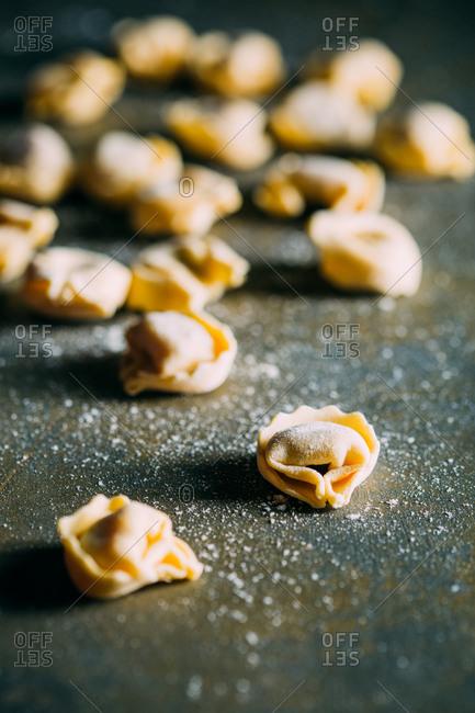 Traditional handmade tortellini on dark background