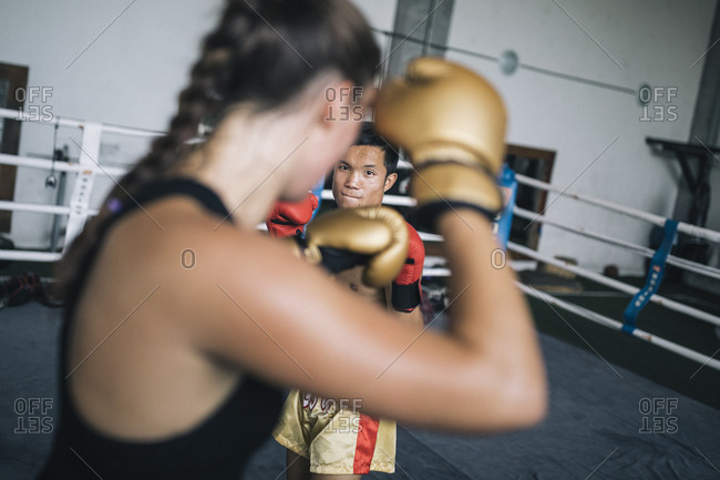 Chiang Mai, Thailand - May 20, 2017: Thays Runge, a German traveler, sparring with her trainer at the Chiangmai Muay Thai Training Center in northern Thailand
