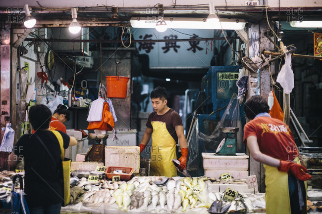 Hong Kong - September 8, 2017: Fishmonger at a local market near Causeway Bay