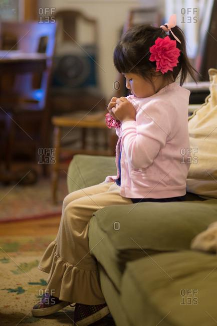 Girl buttoning cardigan