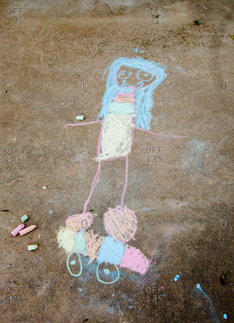 Child's chalk drawing of a person on a skateboard