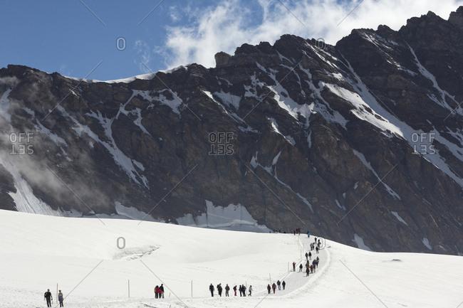 August 5, 2013: Hiking on Aletsch glacier from Jungfraujoch, the highest railway station in the Alps ,Berner Oberland, Interlaken, Switzerland