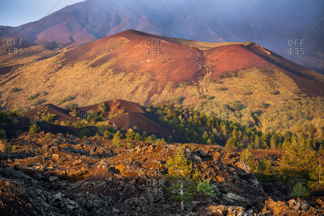The light of dawn illuminates Monte Frumento delle Concazze, a crater formed during the 1865 Etna eruption , Milo, Sicily, Italy