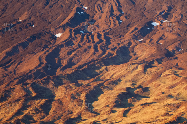 South west face of Mount Etna, the last traces of snow resist in hot summer season, Nicolosi, Sicily, Italy