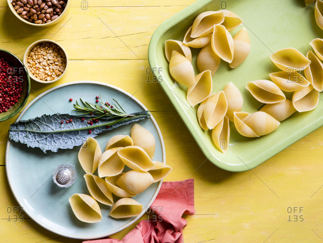 Large pasta shells on colorful plates