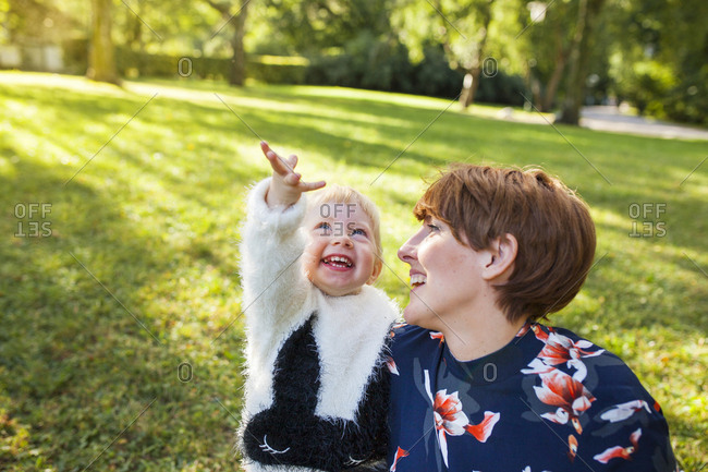 Mother laughing with daughter in park