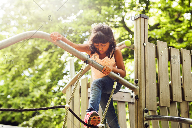 Girl playing in jungle gym