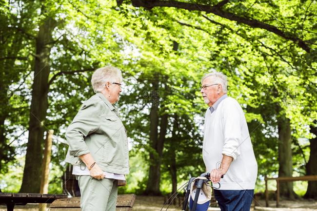 Senior couple talking in park