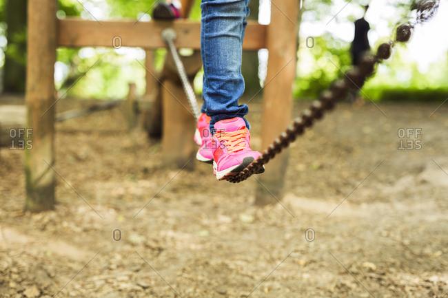 Girl balancing in playground