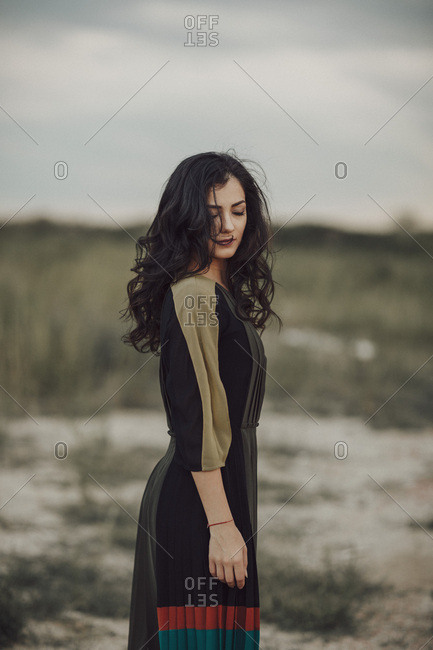 Fashionable woman posing in nature