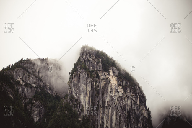 Stawamus Chief Mountain surrounded by fog in Squamish, British Columbia