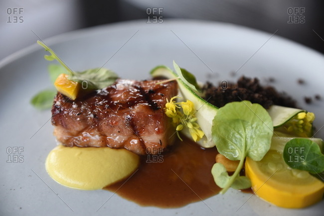 Cherry glazed pork belly dish